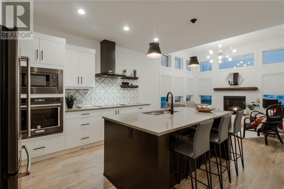For Sale: 660 Aquitania Boulevard West, Lethbridge, AB | 3 Bed, 3 Bath House for $439,000. See 29 photos!