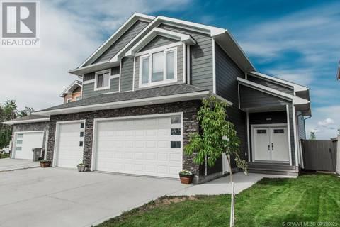 House for sale at 6606 Grande Banks Dr Grande Prairie Alberta - MLS: GP206025