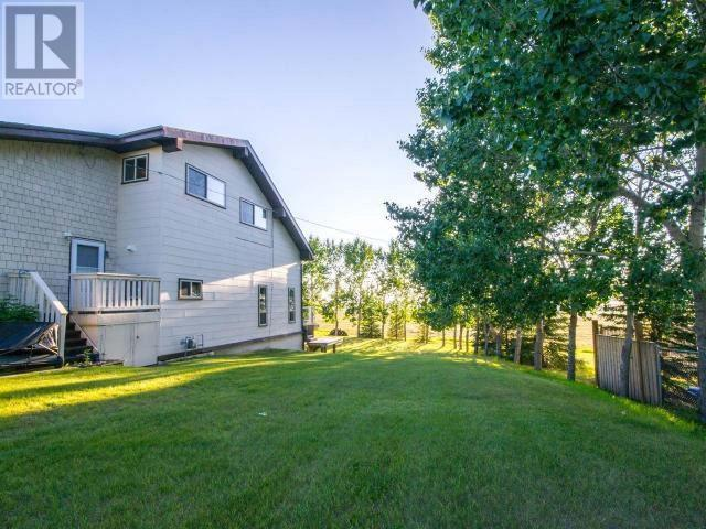 For Sale: 217 Road , Dawson Creek, BC | 5 Bed, 4 Bath House for $617,900. See 53 photos!