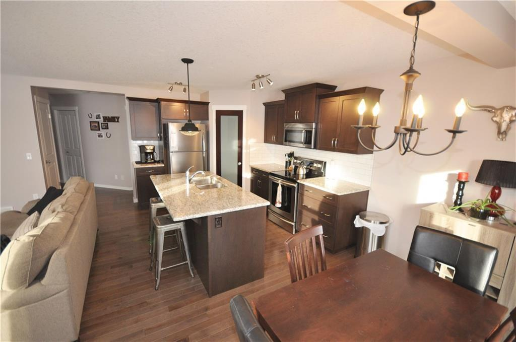 For Sale: 69 Willow Close, Cochrane, AB | 3 Bed, 2 Bath House for $415,000. See 29 photos!