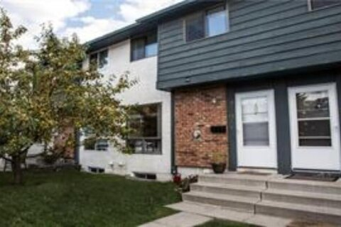 Townhouse for sale at 6915 Ranchview Dr NW Calgary Alberta - MLS: A1021200