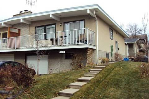 Townhouse for sale at 7011 Hunterville Rd Northwest Calgary Alberta - MLS: C4274805