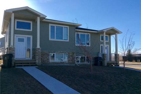 Townhouse for sale at 702 Mt Sundance Ln W Lethbridge Alberta - MLS: LD0161080