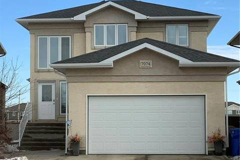 House for sale at 7074 Wascana Cove Dr Regina Saskatchewan - MLS: SK800268