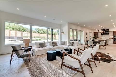 House for sale at 708 Crescent Blvd Southwest Calgary Alberta - MLS: C4246054
