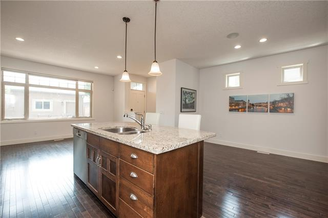 For Sale: 710 33 Street Northwest, Calgary, AB | 3 Bed, 2 Bath Townhouse for $734,900. See 18 photos!