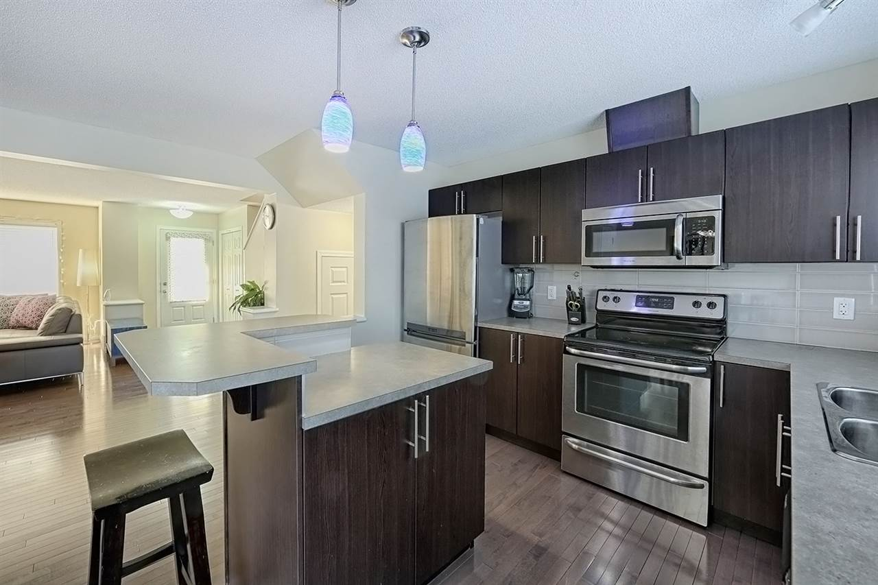 For Sale: 7108 22 Avenue, Edmonton, AB | 3 Bed, 3 Bath Townhouse for $324,000. See 29 photos!