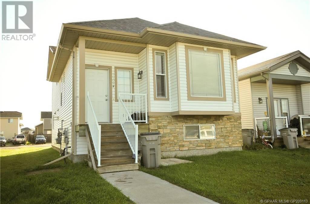 Townhouse for sale at 7109 114a St Grande Prairie Alberta - MLS: GP209113