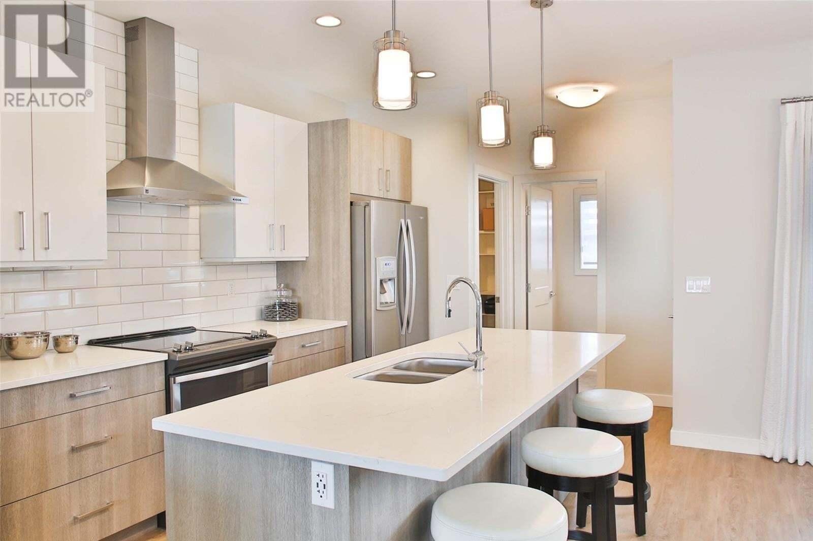 Townhouse for sale at 715 Evergreen Blvd Saskatoon Saskatchewan - MLS: SK828320