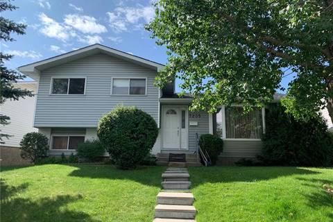 House for sale at 7235 Range Dr Northwest Calgary Alberta - MLS: C4265464