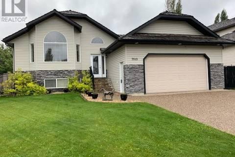House for sale at 7313 102 St Grande Prairie Alberta - MLS: GP205030