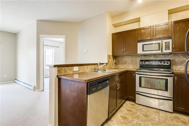 For Sale: 7313 - 70 Panamount Drive Northwest, Calgary, AB | 2 Bed, 2 Bath Condo for $199,900. See 24 photos!