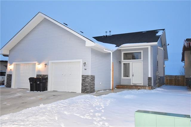 For Sale: 746 Carriage Lane Drive, Carstairs, AB | 3 Bed, 2 Bath Townhouse for $225,000. See 20 photos!