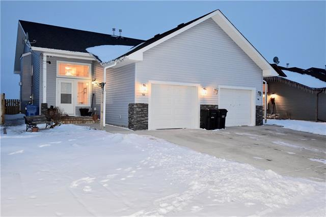 For Sale: 748 Carriage Lane Drive, Carstairs, AB | 3 Bed, 2 Bath Townhouse for $225,000. See 21 photos!