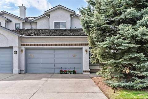 Townhouse for sale at 759 Woodbine Blvd Southwest Calgary Alberta - MLS: C4243493