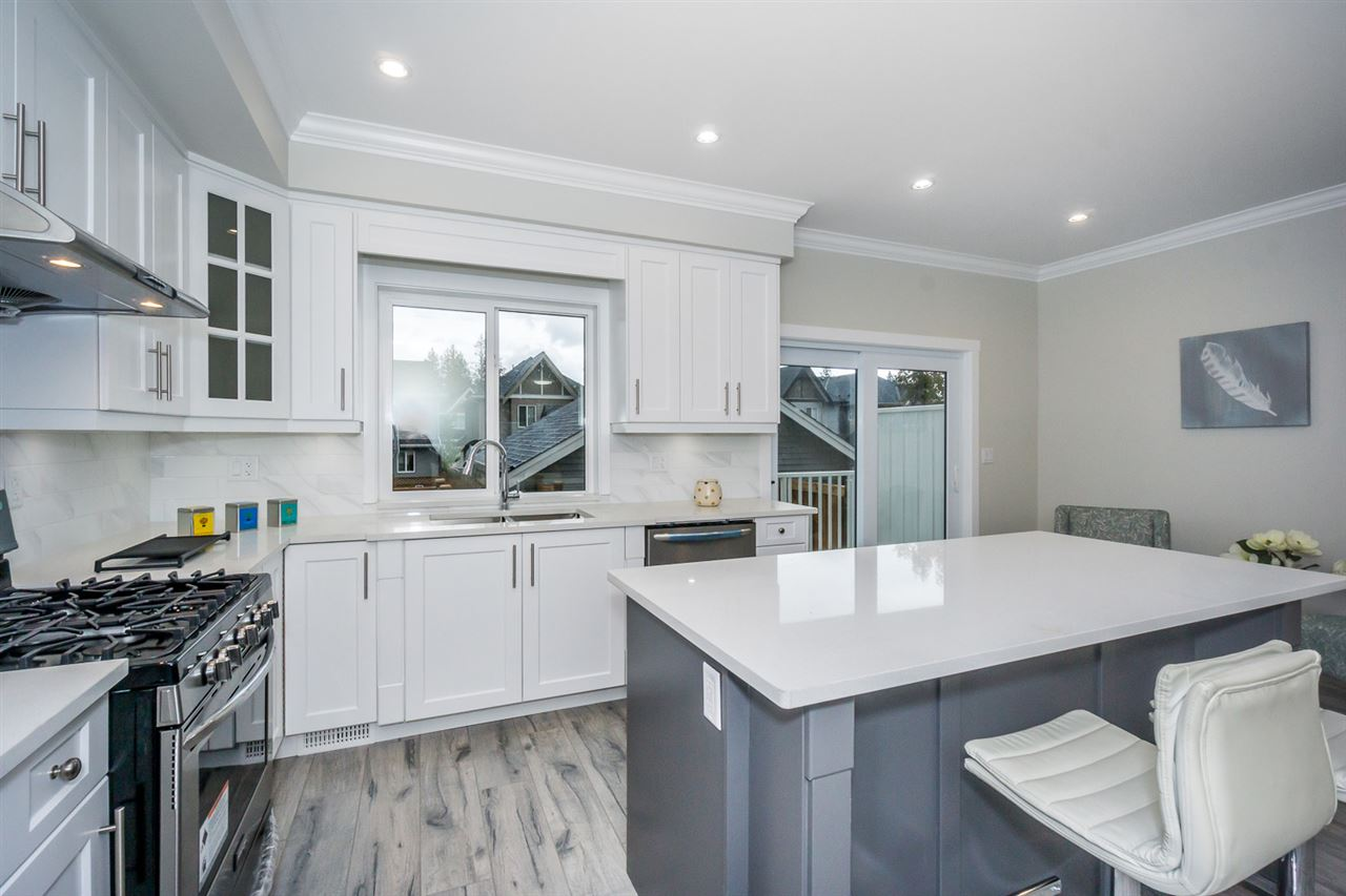 For Sale: 7648 211 Street, Langley, BC | 4 Bed, 4 Bath Townhouse for $829,900. See 19 photos!