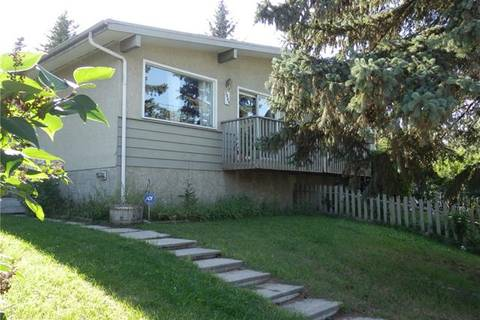 Townhouse for sale at 7809 Bowcliffe Cres Northwest Calgary Alberta - MLS: C4295436