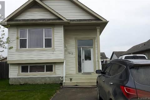 House for sale at 7813 Westpointe Dr Grande Prairie Alberta - MLS: GP207520