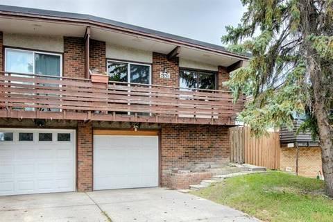 Townhouse for sale at 7831 Hunterquay Rd Northwest Calgary Alberta - MLS: C4263286