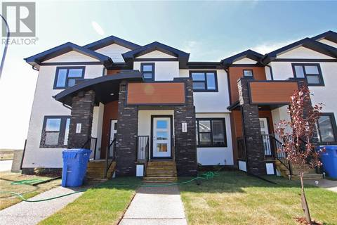 Townhouse for sale at 7905 Canola Ave Regina Saskatchewan - MLS: SK770917
