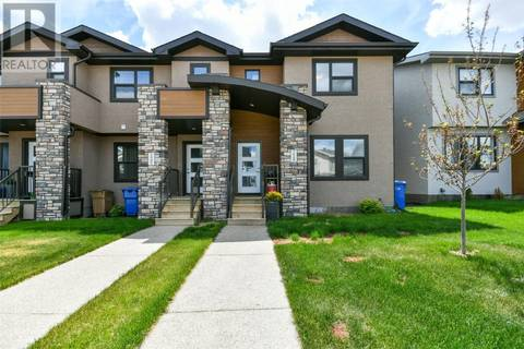 Townhouse for sale at 7949 Canola Ave Regina Saskatchewan - MLS: SK777066