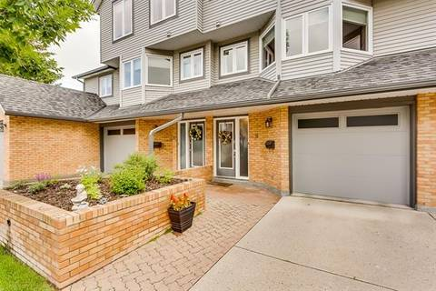Townhouse for sale at 8 Coachway Green Southwest Calgary Alberta - MLS: C4257312
