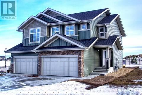 Townhouse for sale at 8 Springfield Blvd Sylvan Lake Alberta - MLS: ca0156235