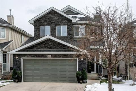 House for sale at 8006 Cougar Ridge Ave Southwest Calgary Alberta - MLS: C4242636
