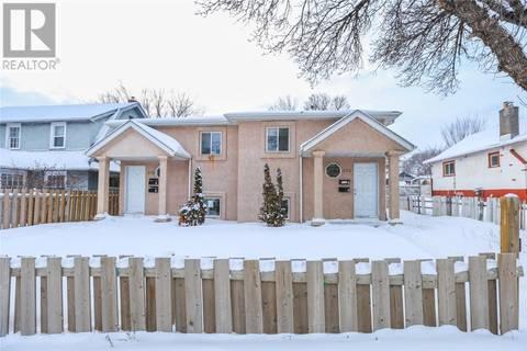 Townhouse for sale at 825 Idylwyld Dr N Saskatoon Saskatchewan - MLS: SK759065