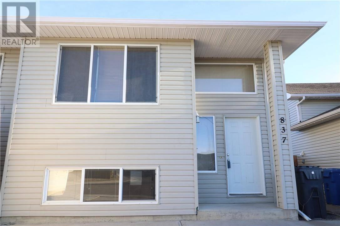 Townhouse for sale at 837 Blackfoot Te W Lethbridge Alberta - MLS: ld0187987