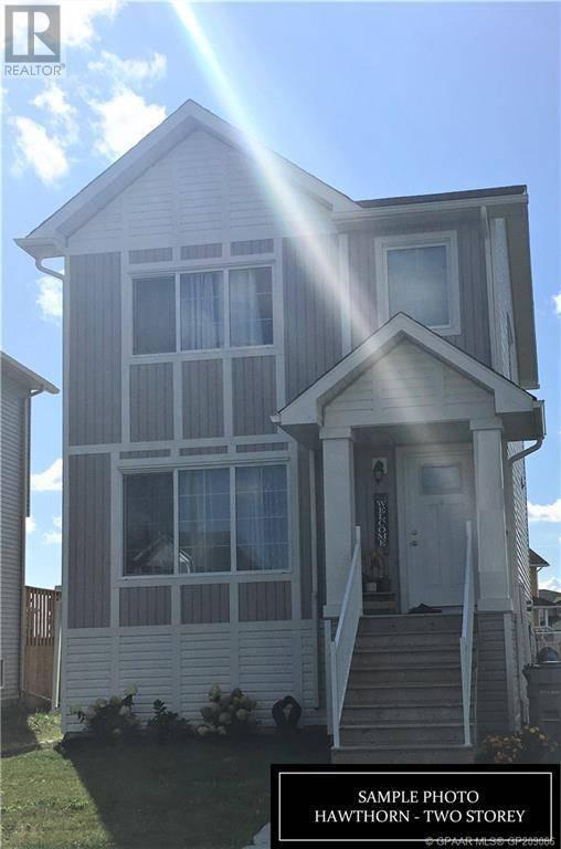 House for sale at 8418 102 Ave Grande Prairie Alberta - MLS: GP209066
