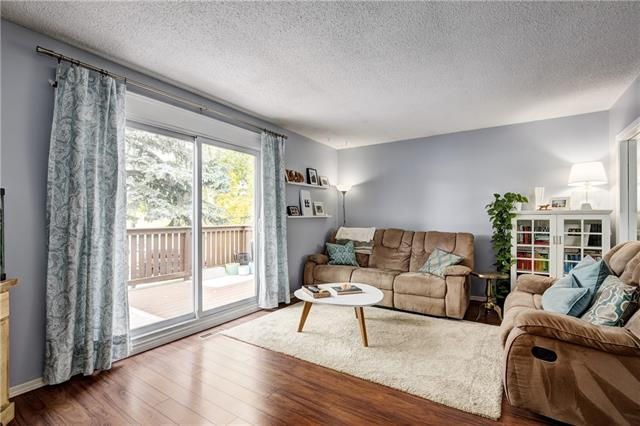 For Sale: 8608 Berwick Road Northwest, Calgary, AB | 4 Bed, 2 Bath Townhouse for $334,900. See 23 photos!