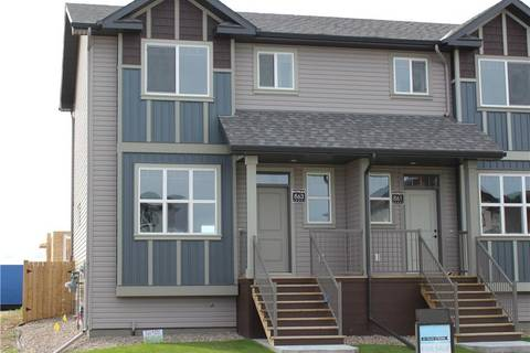 Townhouse for sale at 863 Greywolf Run N Lethbridge Alberta - MLS: LD0179876