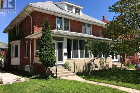 Townhouse for sale at 864 Dougall  Windsor Ontario - MLS: 18009304