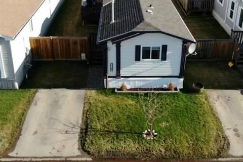 House for sale at 8830 89 Ave Grande Prairie Alberta - MLS: GP205300