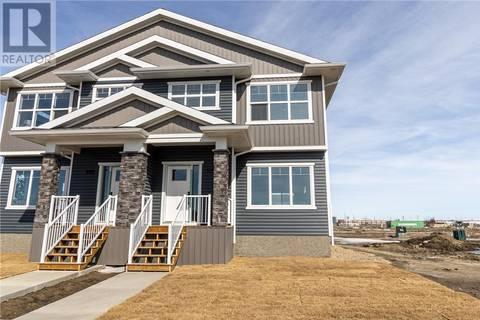 Townhouse for sale at 891 Mcfaull Ri Saskatoon Saskatchewan - MLS: SK803960