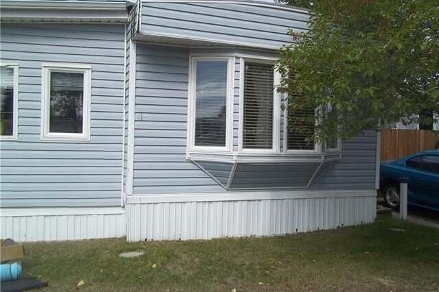Home for sale at 90 Greenbrook Village Brooks Alberta - MLS: SC0194323
