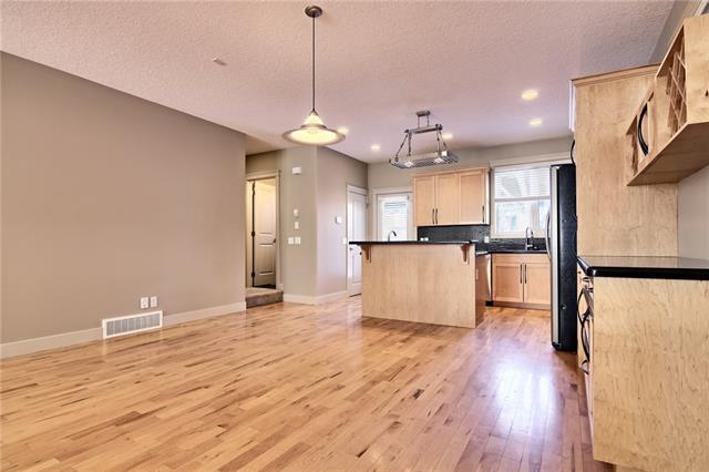 For Sale: 911 33a Street Northwest, Calgary, AB | 4 Bed, 3 Bath Townhouse for $749,900. See 37 photos!