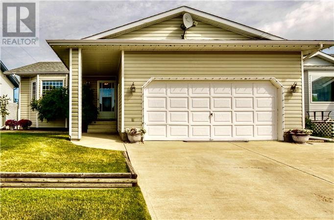 For Sale: 9110 - 107 Avenue , Grande Prairie, AB | 3 Bed, 3 Bath House for $338,800. See 30 photos!