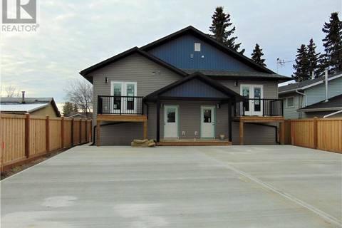 House for sale at 9322 102 Ave Grande Prairie Alberta - MLS: GP202202