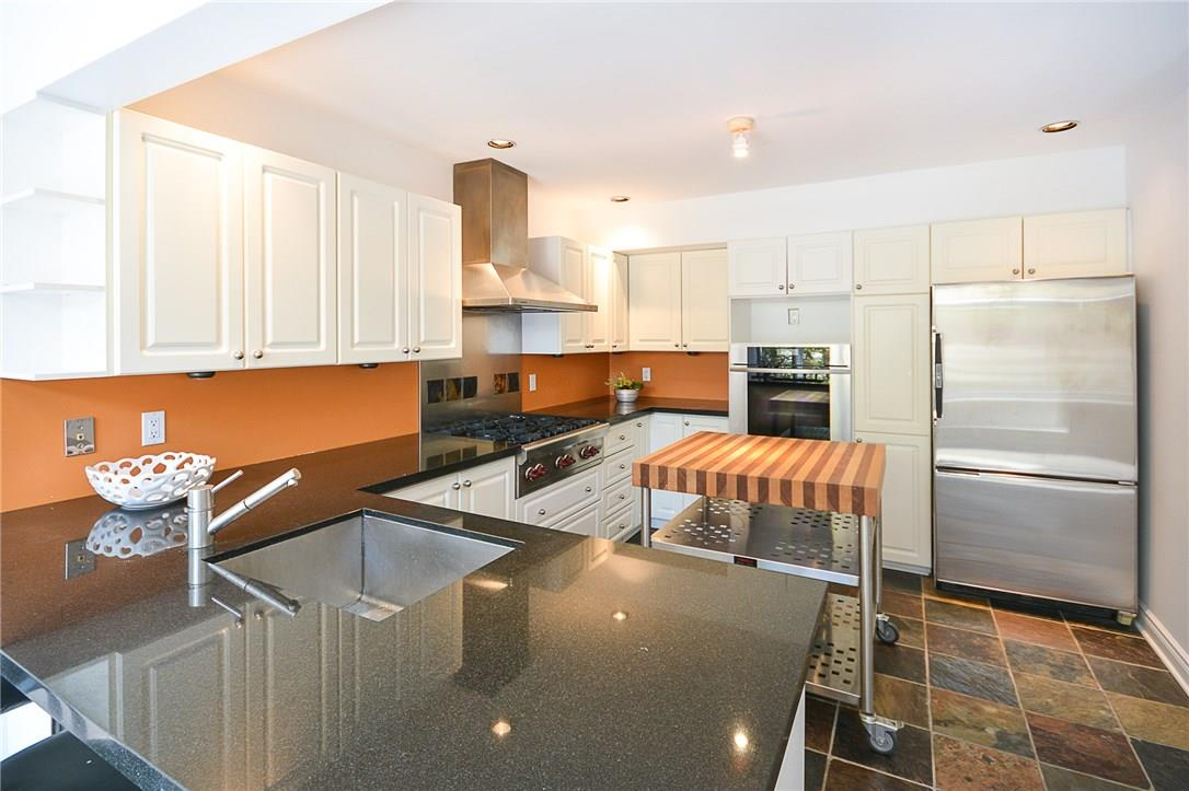 For Sale: 954 Green Valley Crescent, Ottawa, ON | 3 Bed, 4 Bath House for $675,000. See 24 photos!
