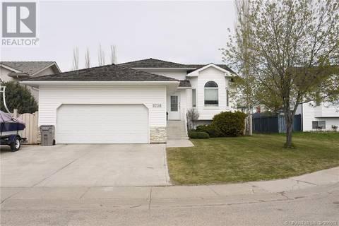 House for sale at 9708 62 Ave Grande Prairie Alberta - MLS: GP205563