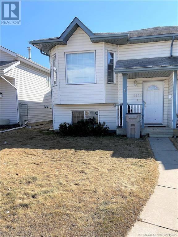 House for sale at 9739 124 Ave Grande Prairie Alberta - MLS: GP215265