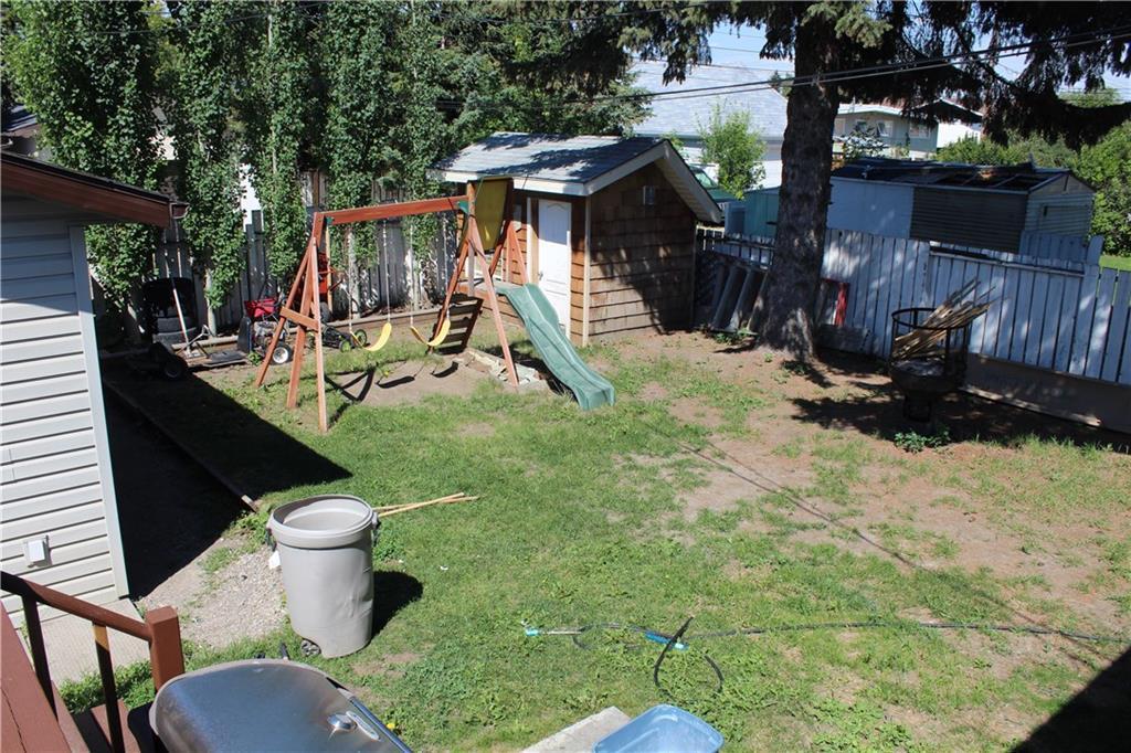 For Sale: 9739 Academy Drive Southeast, Calgary, AB | 4 Bed, 2 Bath House for $415,000. See 5 photos!