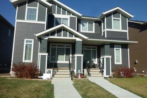 Townhouse for sale at 98 Fireside Cove Cochrane Alberta - MLS: A1021870