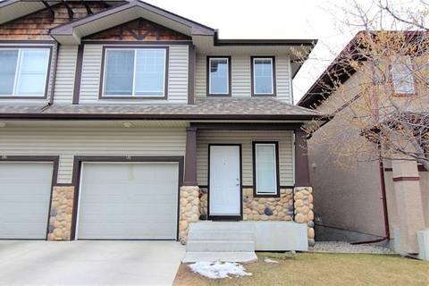 Townhouse for sale at 98 Hidden Creek Ri Northwest Calgary Alberta - MLS: C4242349
