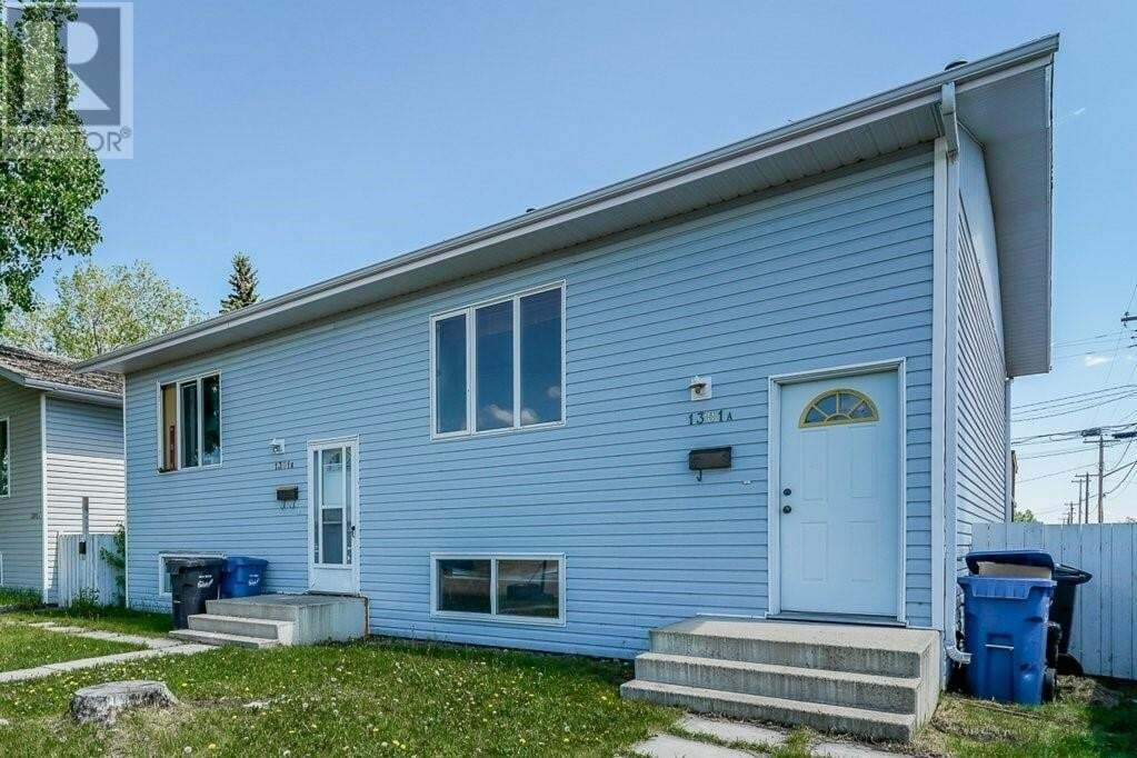 Townhouse for sale at 1301 Fleming Ave Unit A&B Penhold Alberta - MLS: ca0189070
