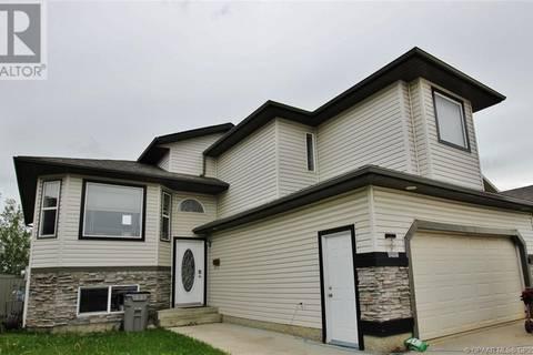 House for sale at 5 Pinnacle  Unit Key Grande Prairie Alberta - MLS: GP207340