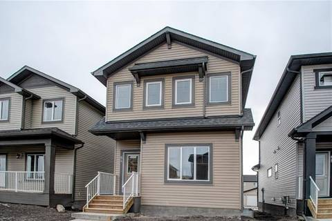 House for sale at 64 Reunion Lp Unit Lo Airdrie Alberta - MLS: C4239222
