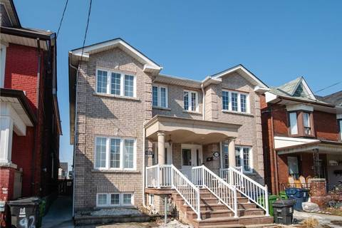 Townhouse for rent at 94 Mulock Ave Unit Main Toronto Ontario - MLS: W4391406